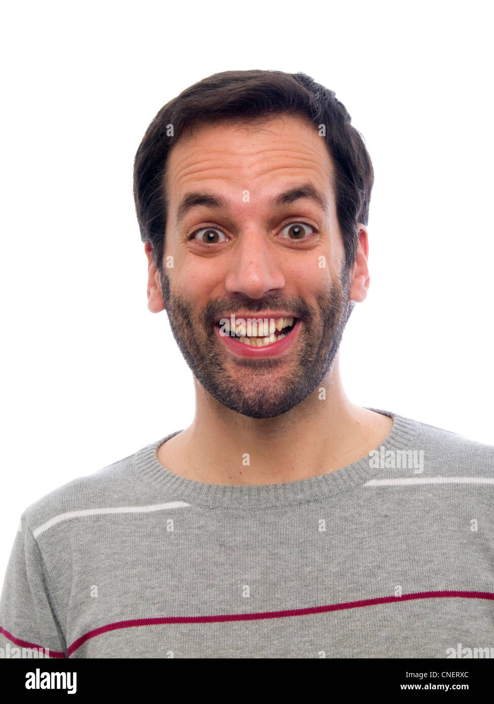 Portrait d'un jeune homme surpris avec beard looking at camera Photo Stock