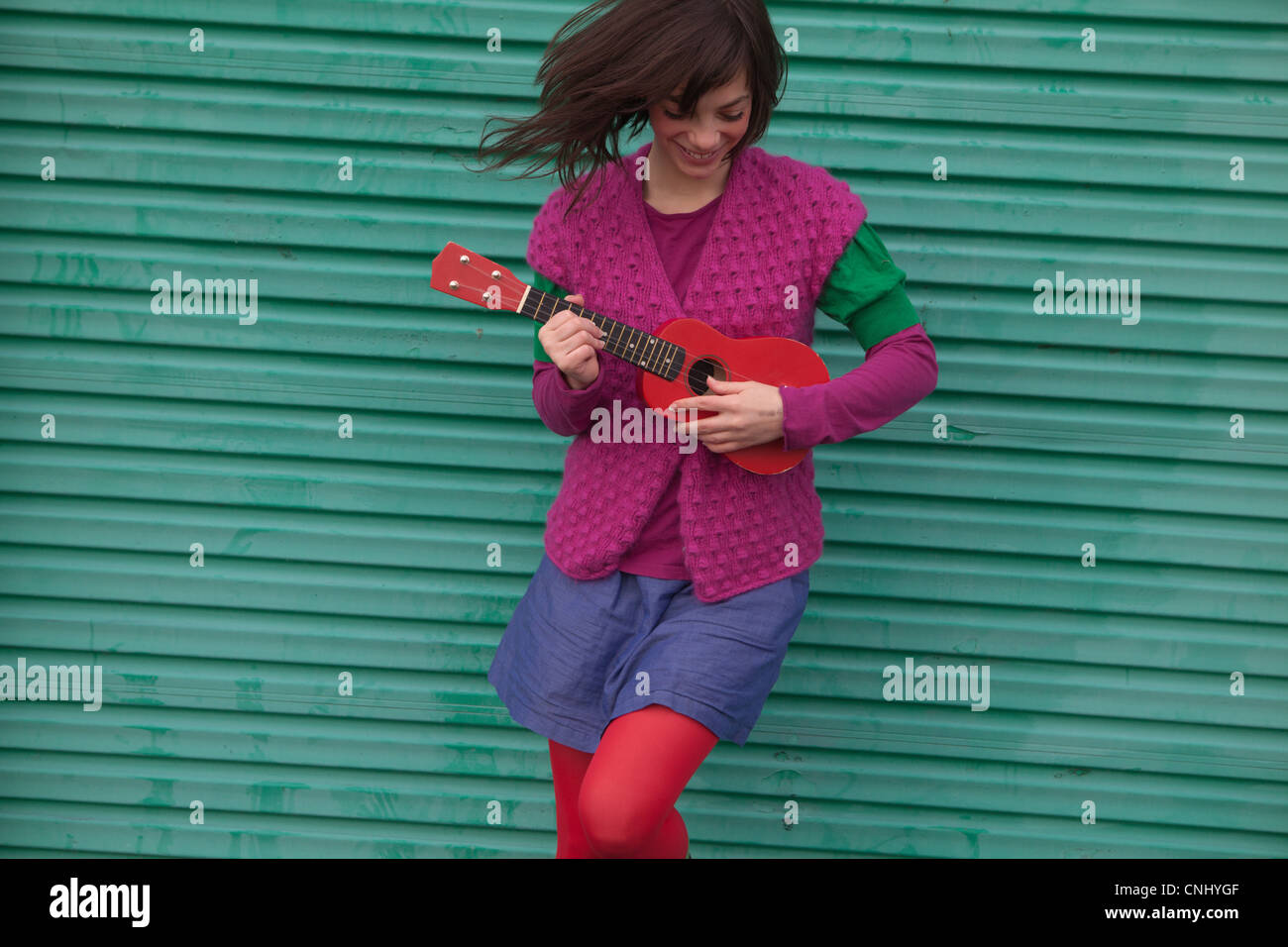 Young woman playing ukulele Photo Stock