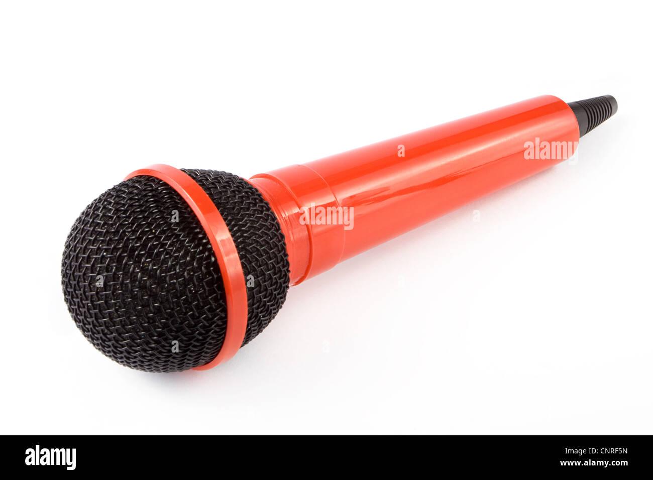 Microphone rouge sur fond blanc Photo Stock