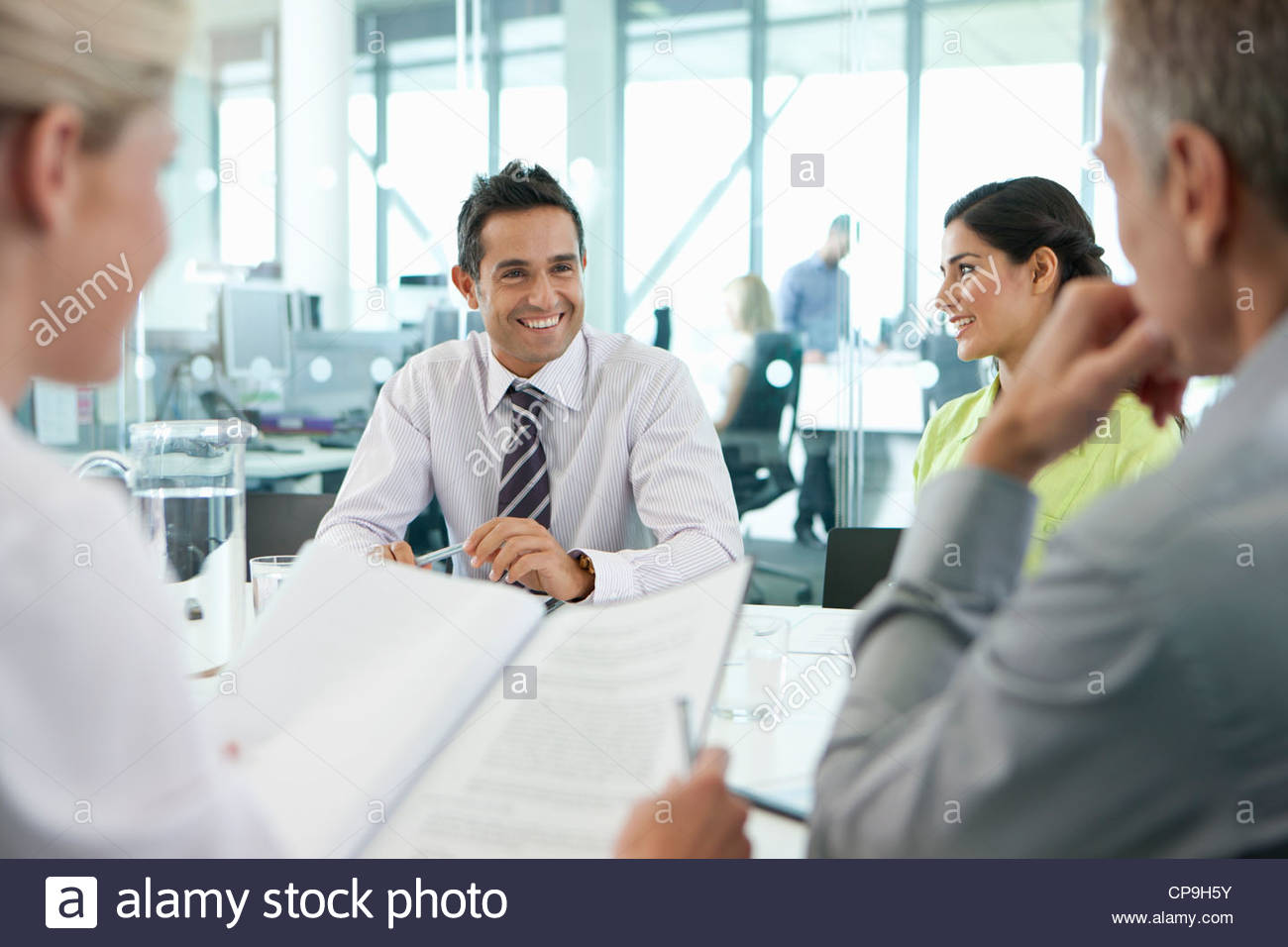 Smiling business people meeting in conference room Photo Stock