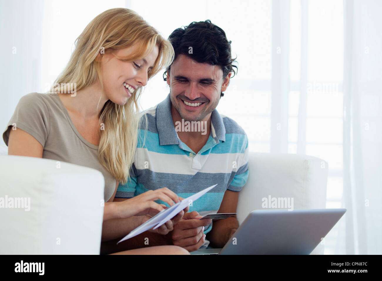 Couple paying bill online Photo Stock