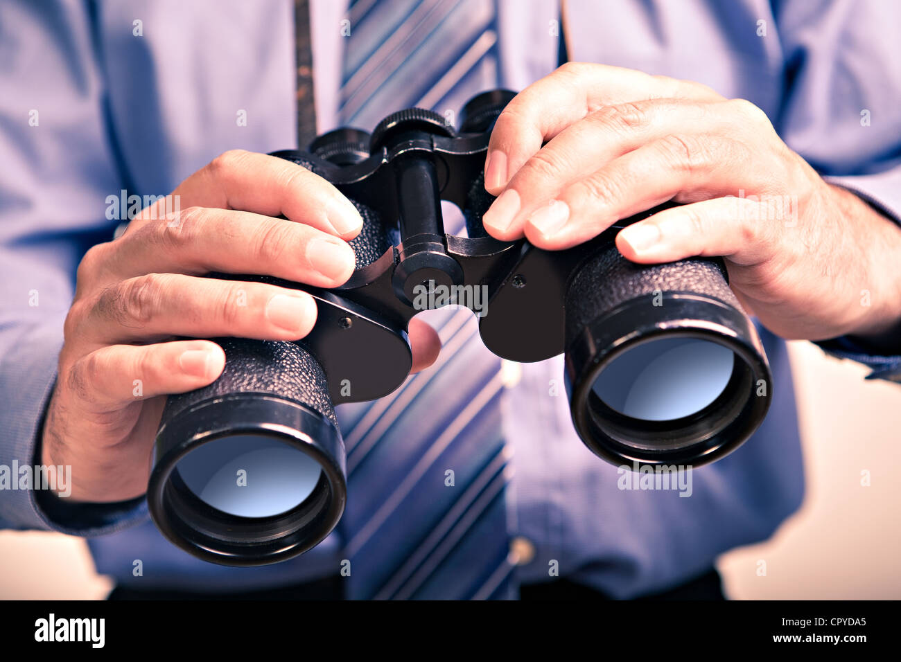 Portrait of a businessman with spyglass Photo Stock
