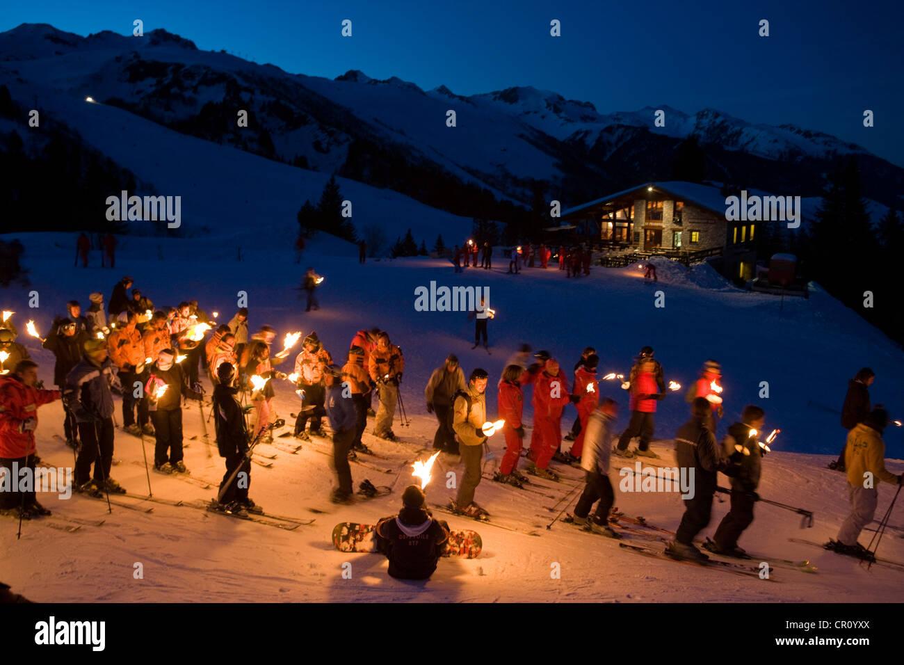 France, Savoie, Valmorel, procession aux flambeaux du restaurant le Prariond Photo Stock