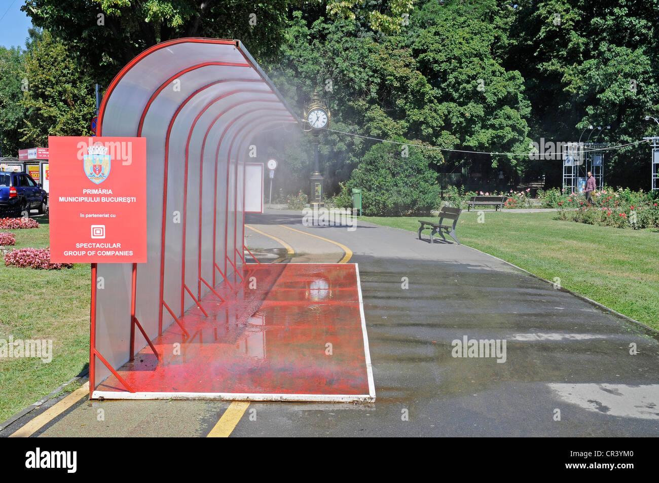 Système d'arrosage de l'eau publique, le temps chaud, l'eau, circuit de refroidissement, l'été, Photo Stock