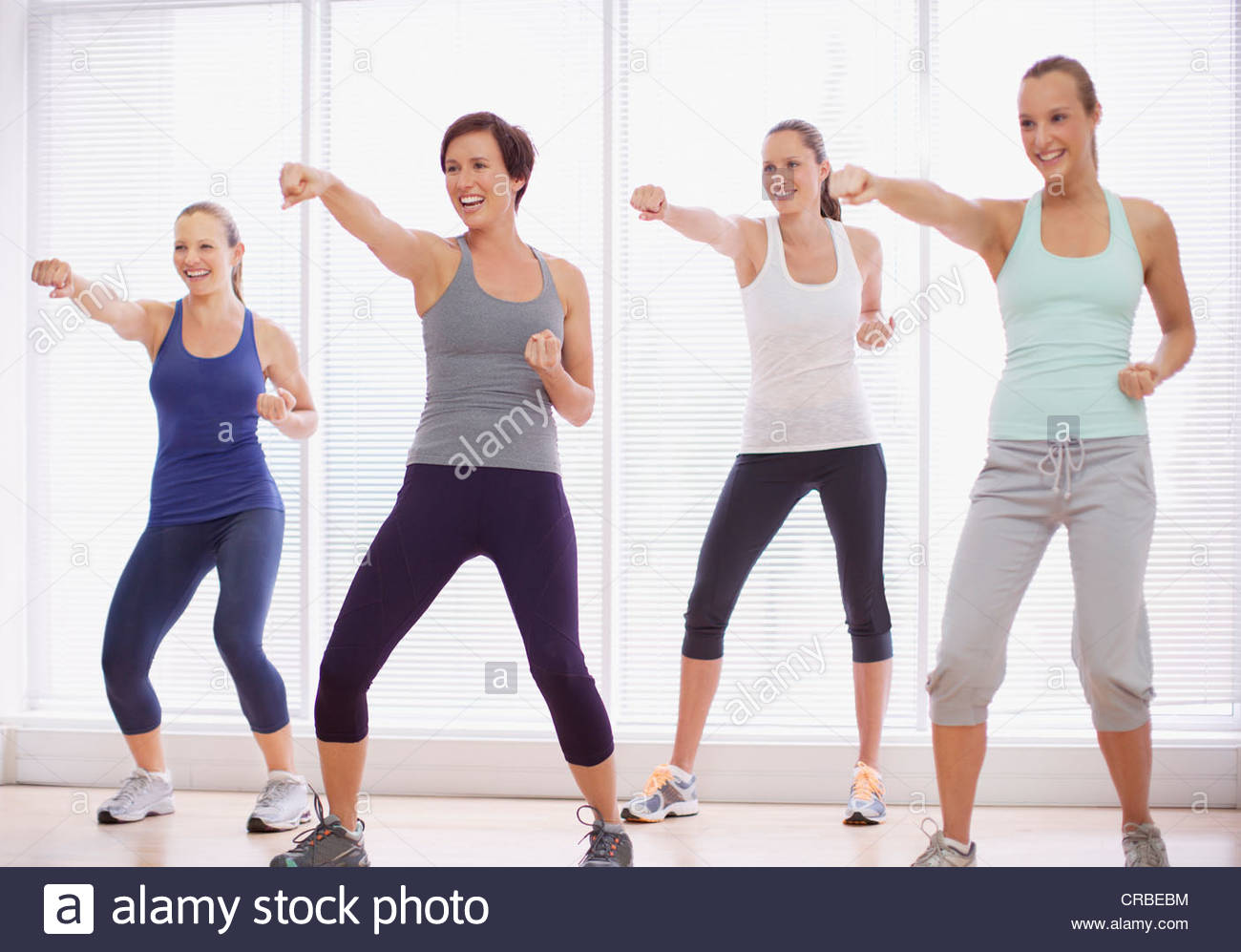 Smiling women in exercise class Photo Stock