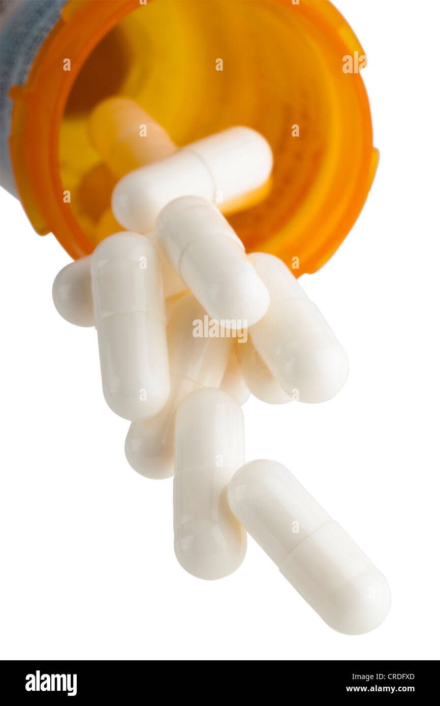 Comprimés en tombant de prescription bottle Photo Stock