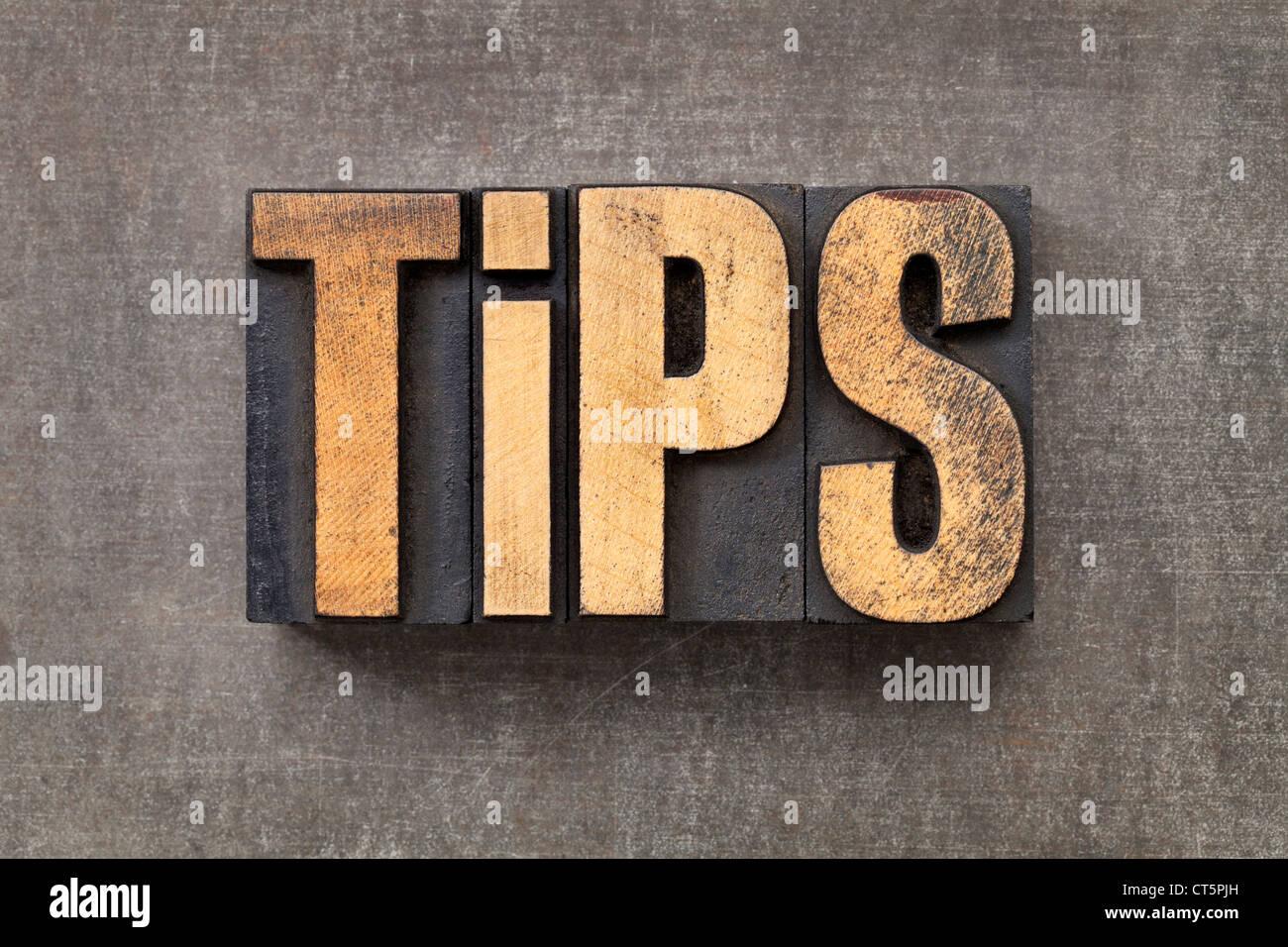 Word - conseils du texte dans la typographie vintage bois type contre un grunge metal sheet Photo Stock