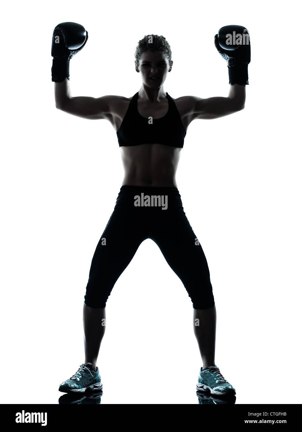 Un caucasian woman l'exercice de boxe entraînement de fitness silhouette en posture studio isolé sur fond blanc Banque D'Images