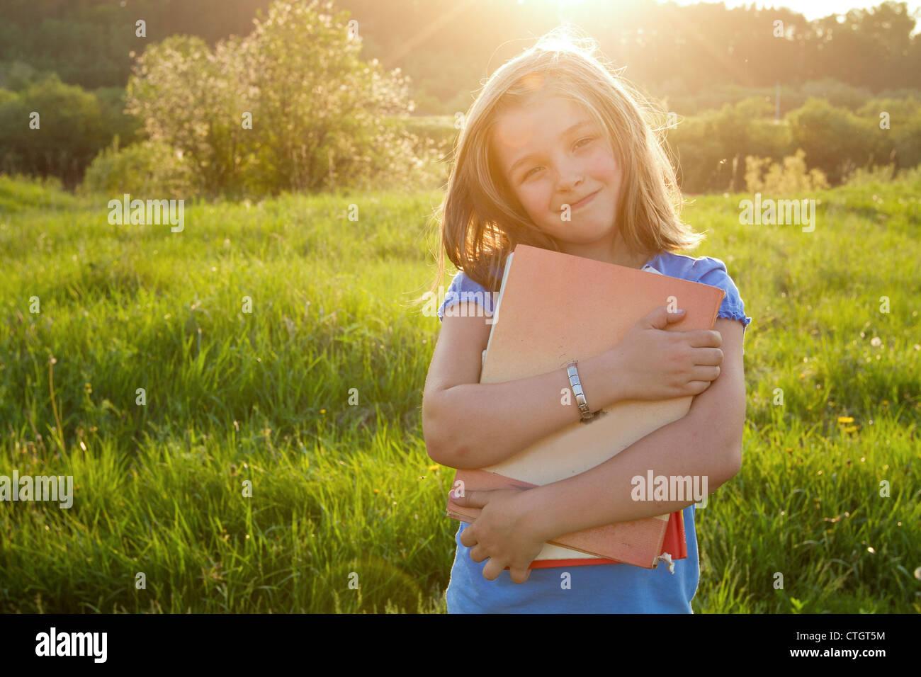 fille avec livre Photo Stock