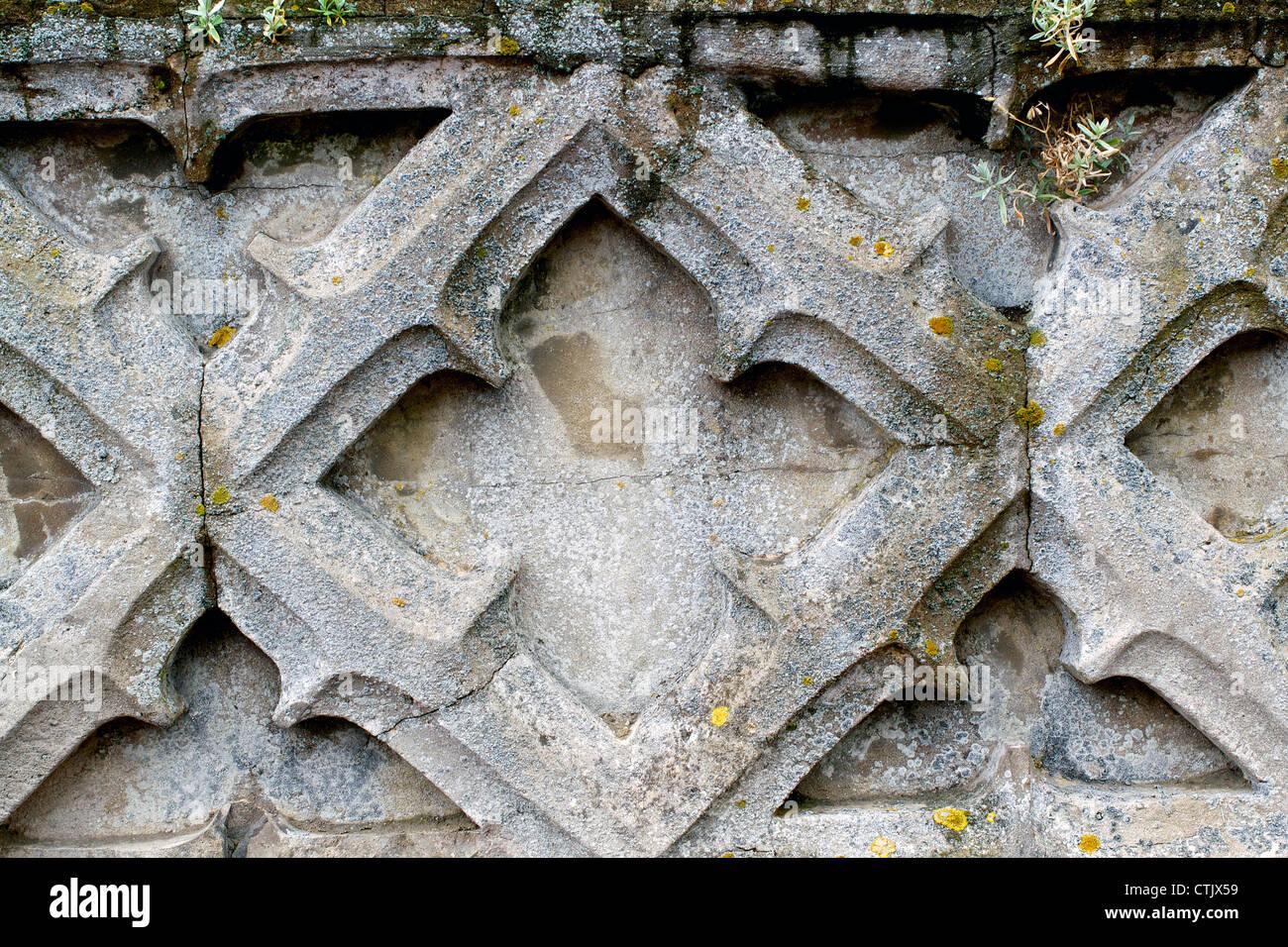 Un vieux mur avec une certaine usure grave Photo Stock
