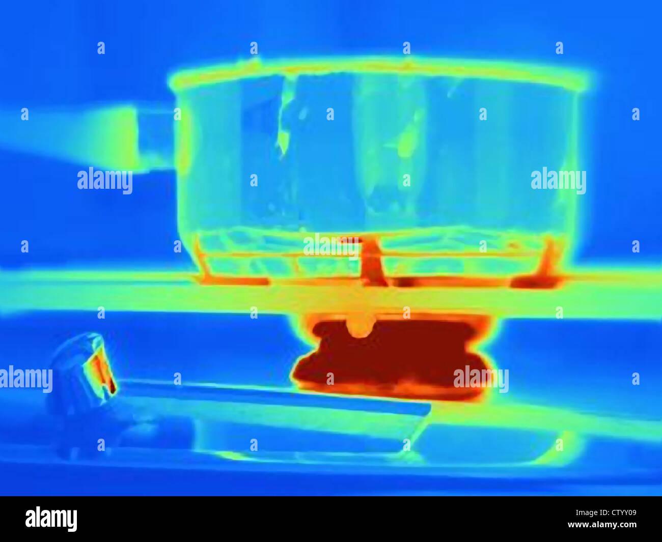 Image thermique du pot sur cuisinière Photo Stock