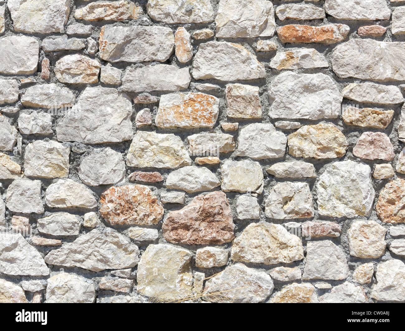 Mur de pierre bloc fabriqué à partir de blocs de pierre de taille irrégulière Photo Stock