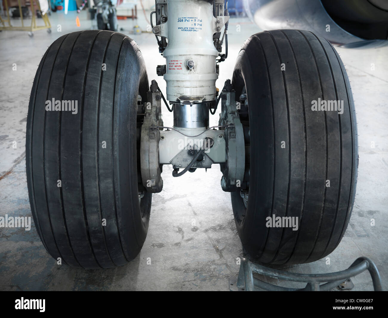 Close up of airplane wheels in hangar Photo Stock