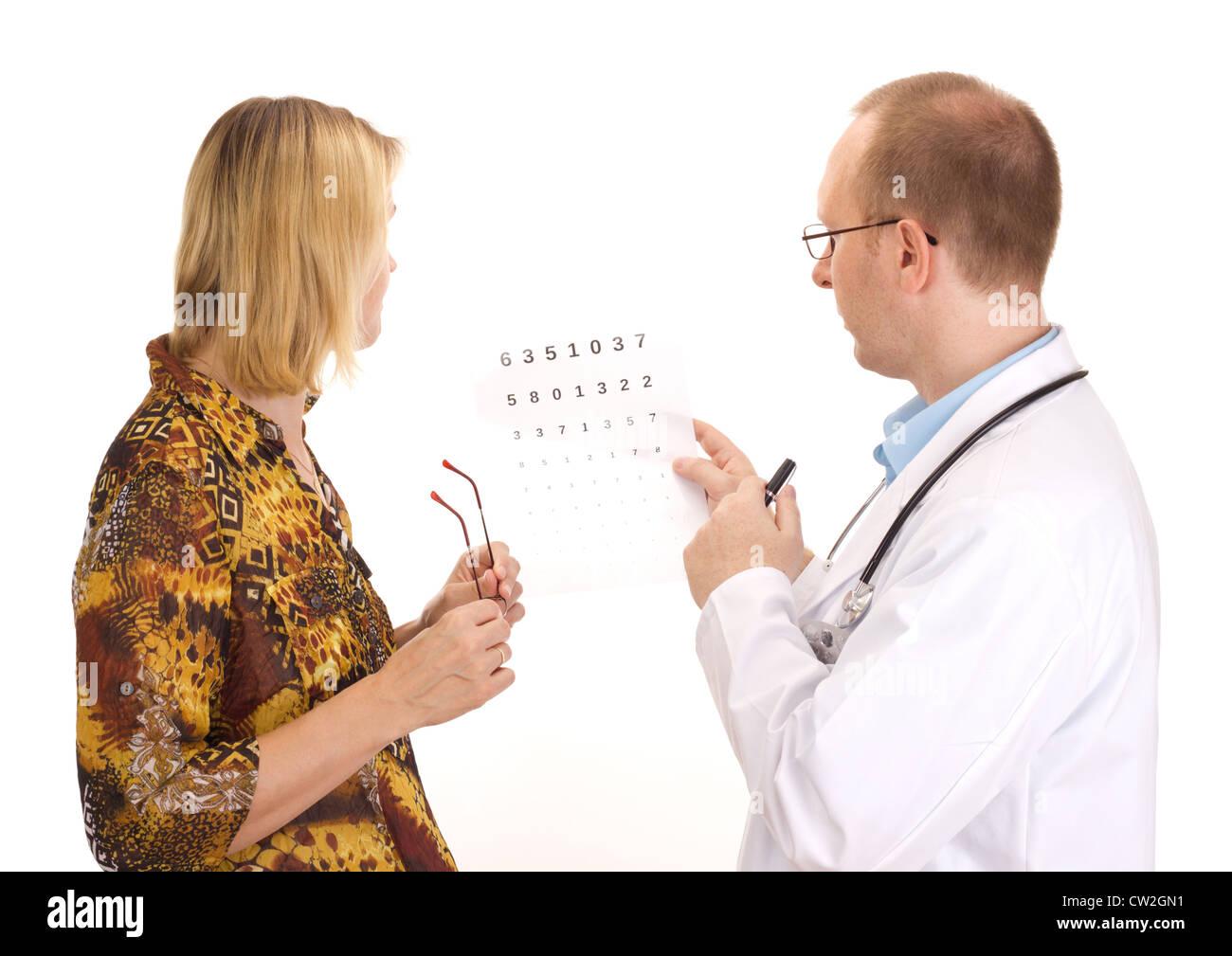 Patient par un ophtalmologiste. Photo Stock