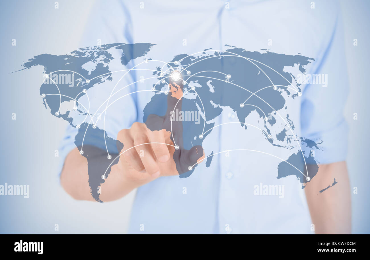 Man on world map with futuristic interface de communication. Photo Stock