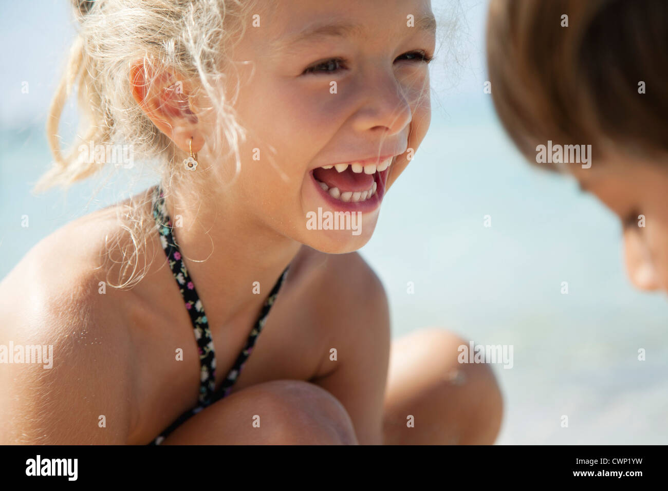Girl laughing outdoors Photo Stock