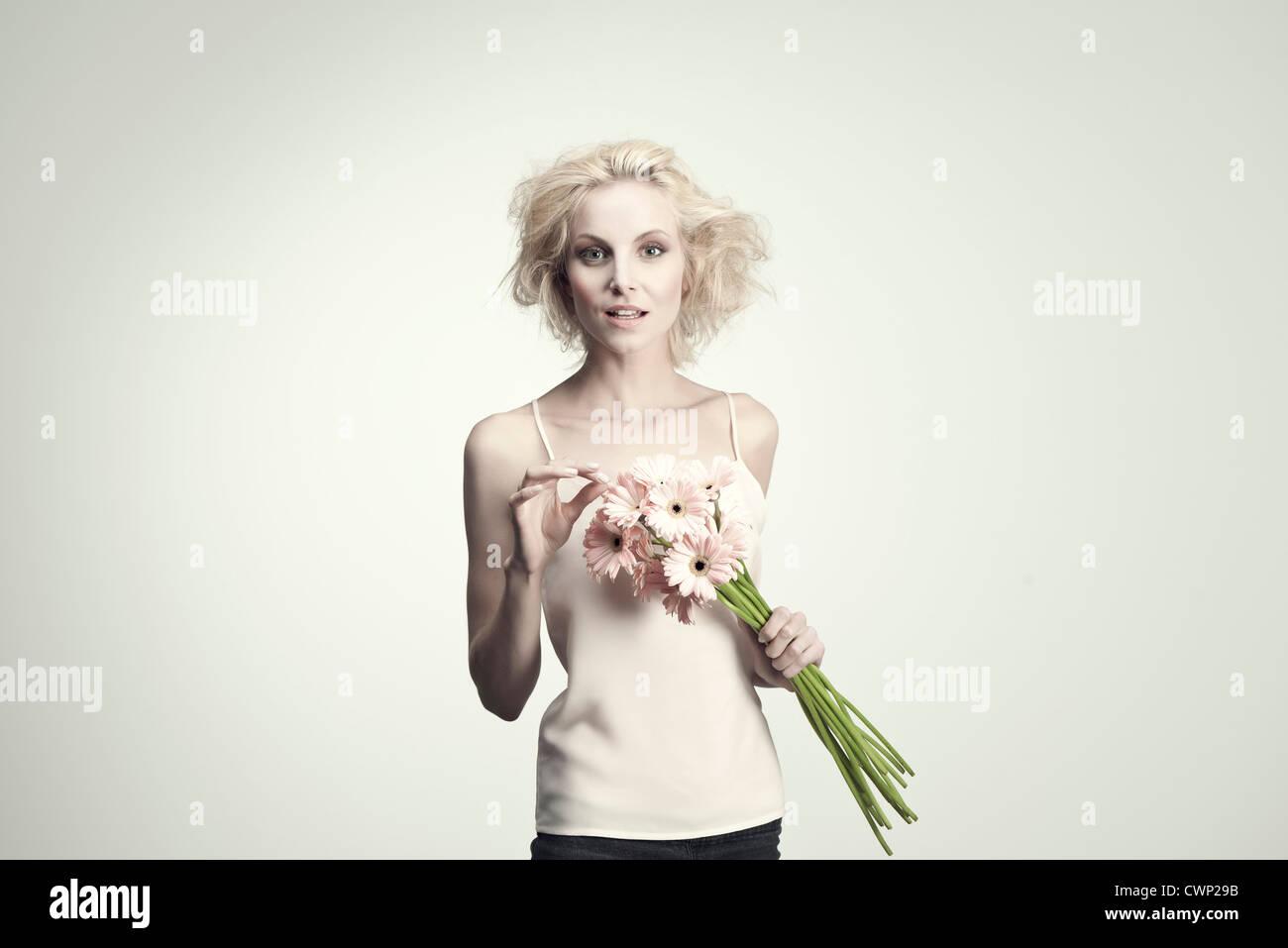 Young woman holding bouquet de gerberas Photo Stock