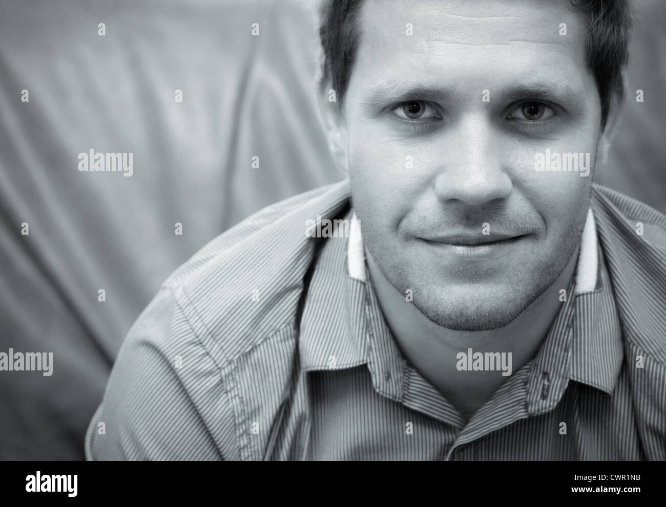 Close up of a businessman avec un visage confiant et optimiste Photo Stock