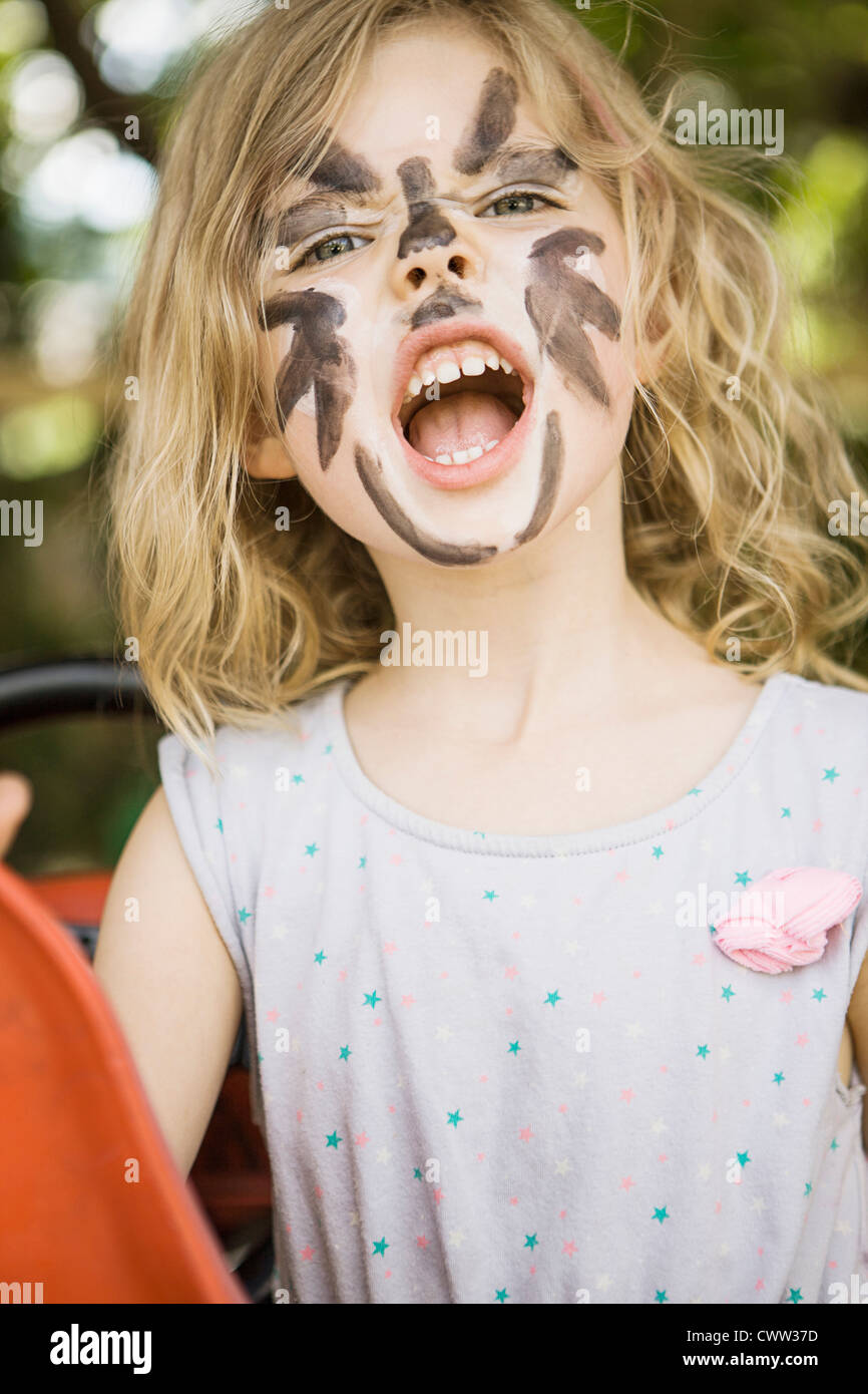 Girl wearing face paint en plein air Photo Stock