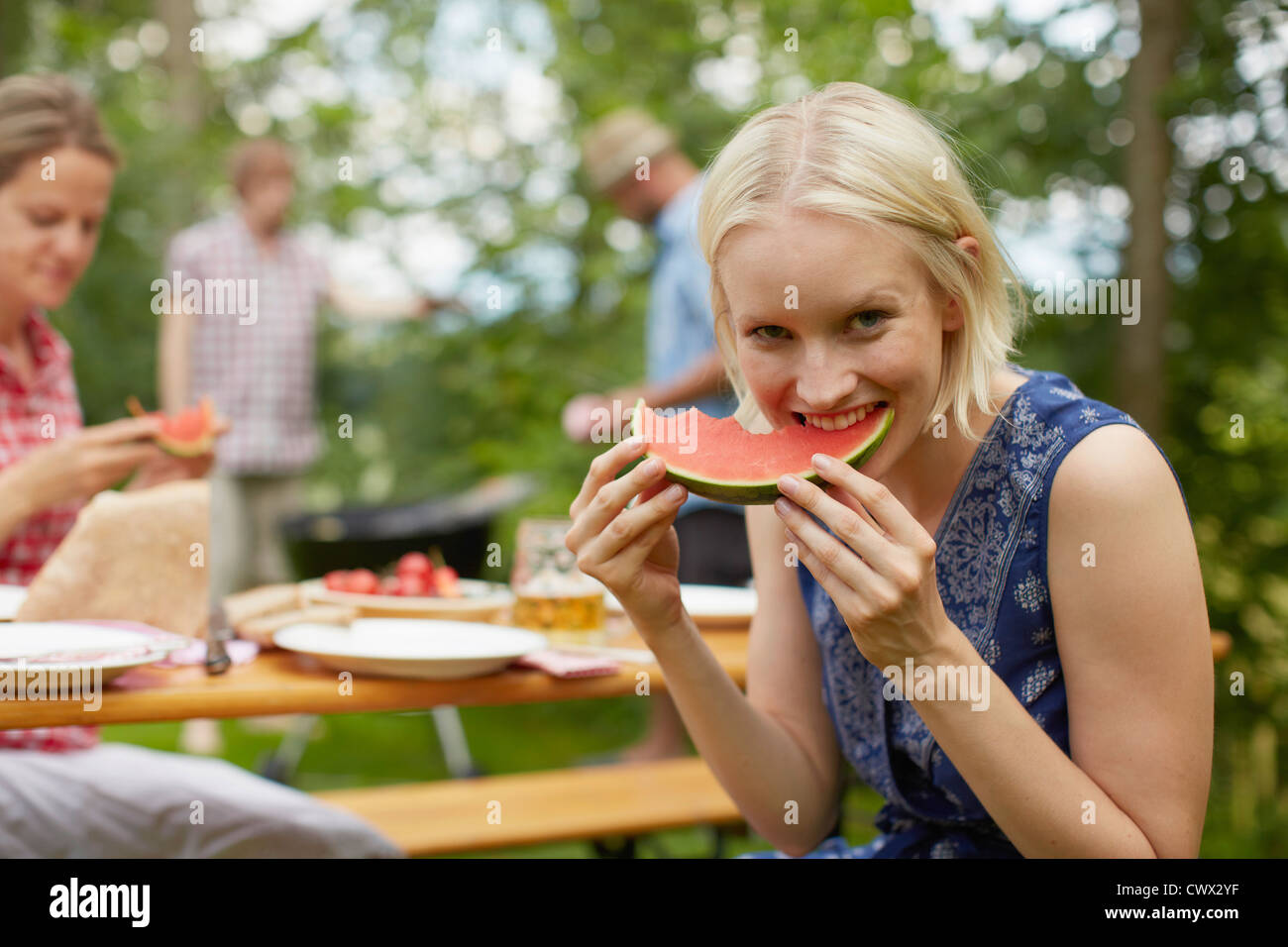 Woman eating watermelon outdoors Photo Stock