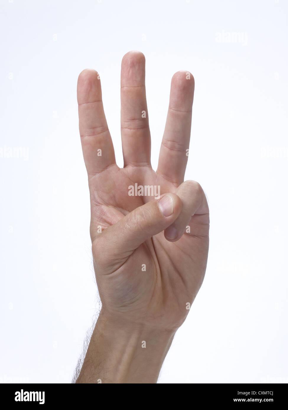 Geste de la main avec trois doigts Photo Stock