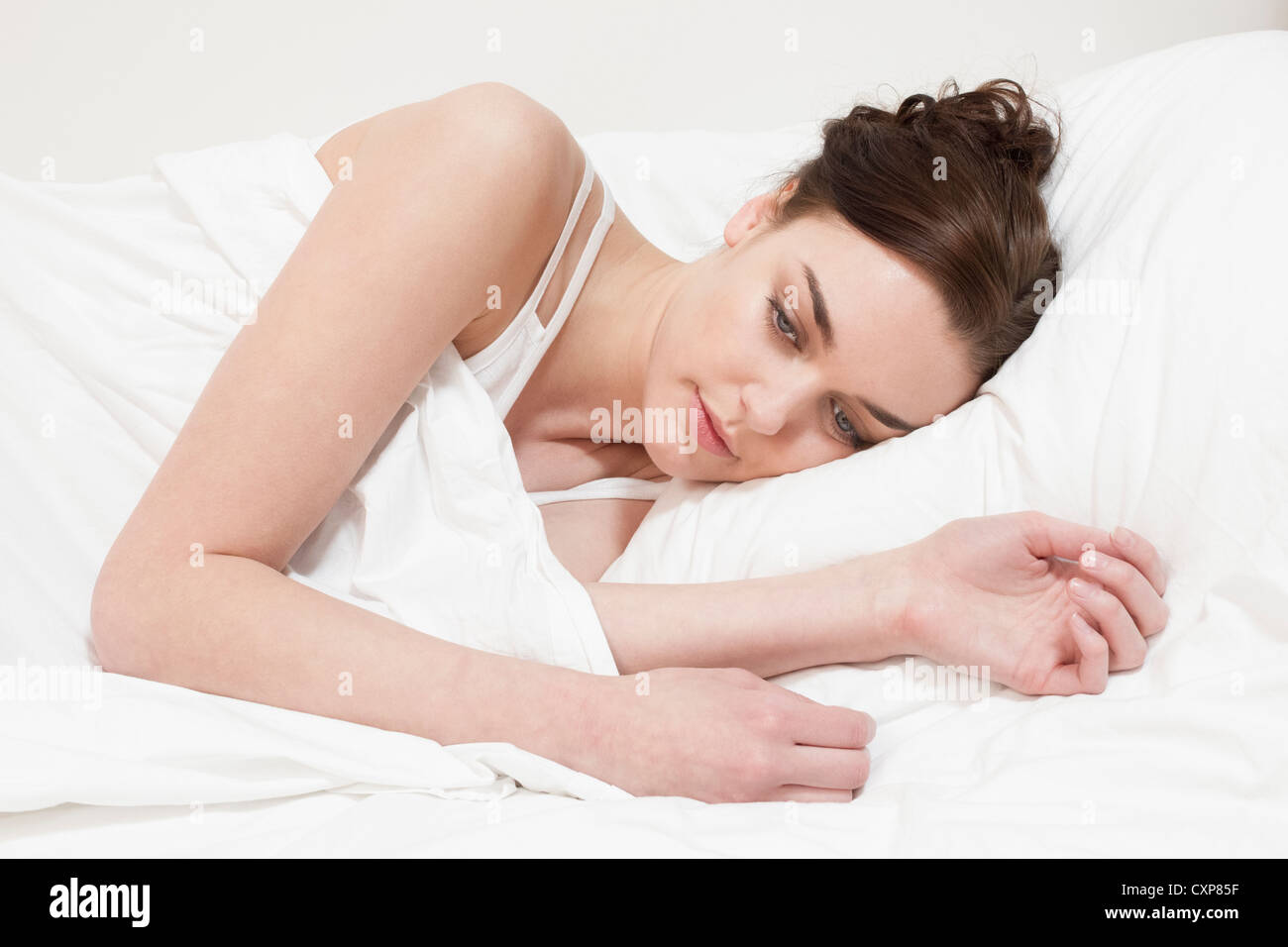 Woman Lying in Bed awake Photo Stock