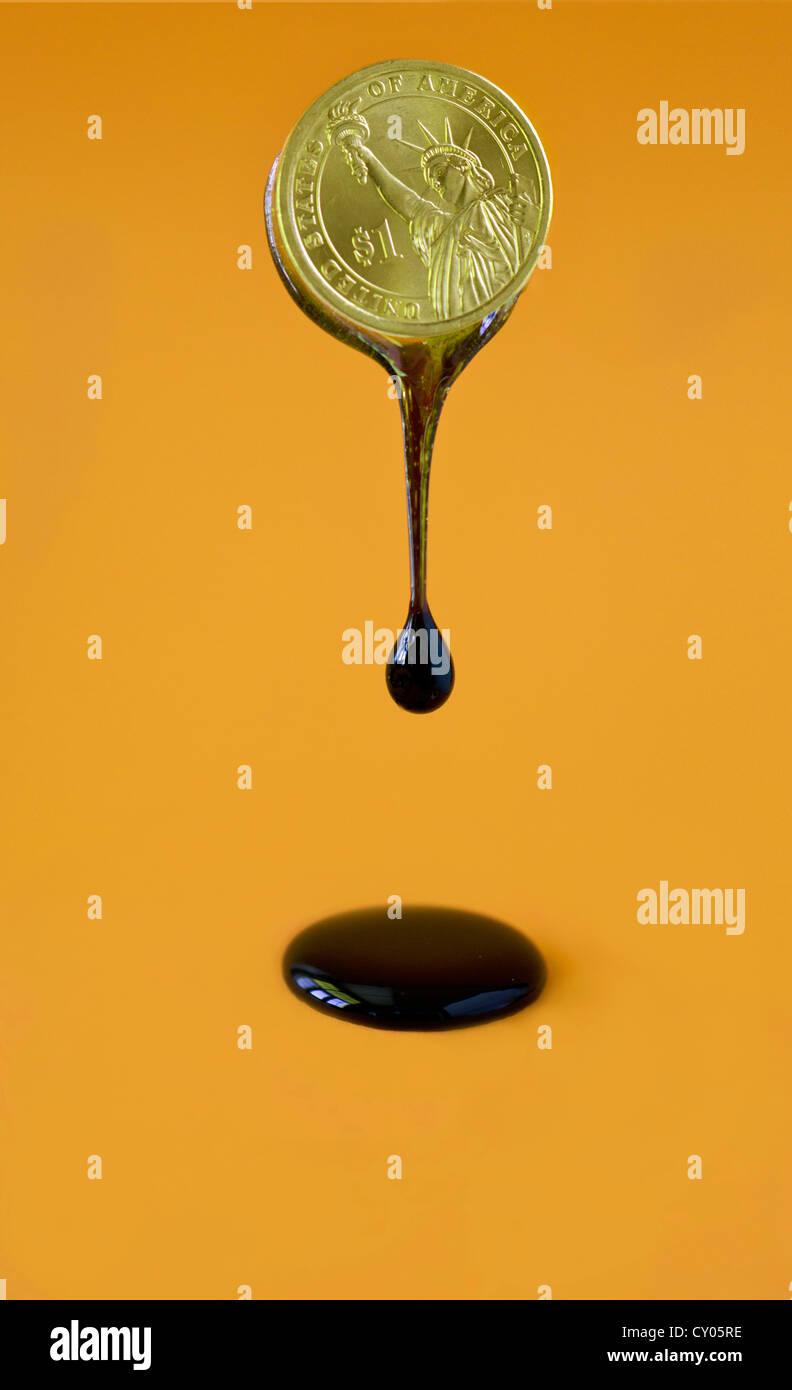 Purge d'huile à partir de la pièce de un dollar US Photo Stock