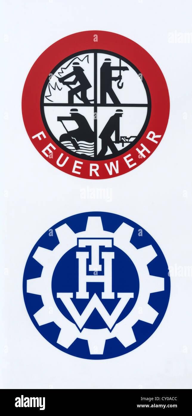 Logos de la fire department, 'rescue, éteindre, sauver, protéger', et THW, Technisches Hilfswerk, protection civile Banque D'Images