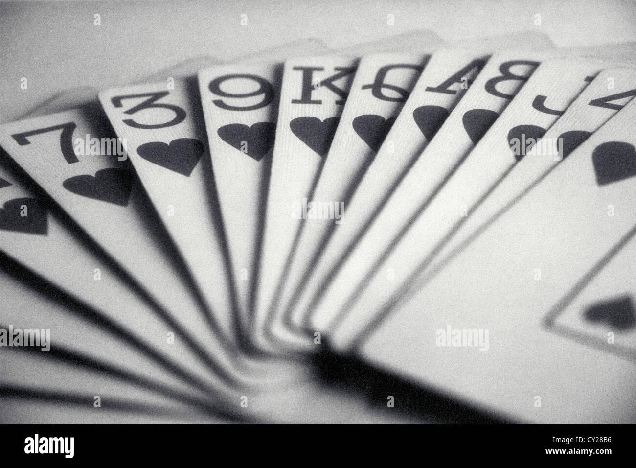 Main de cartes à jouer avec tous les cœurs, ©mak Photo Stock