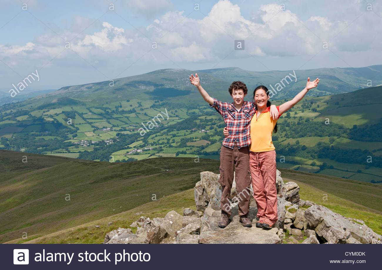 Couple standing on rural hilltop Photo Stock