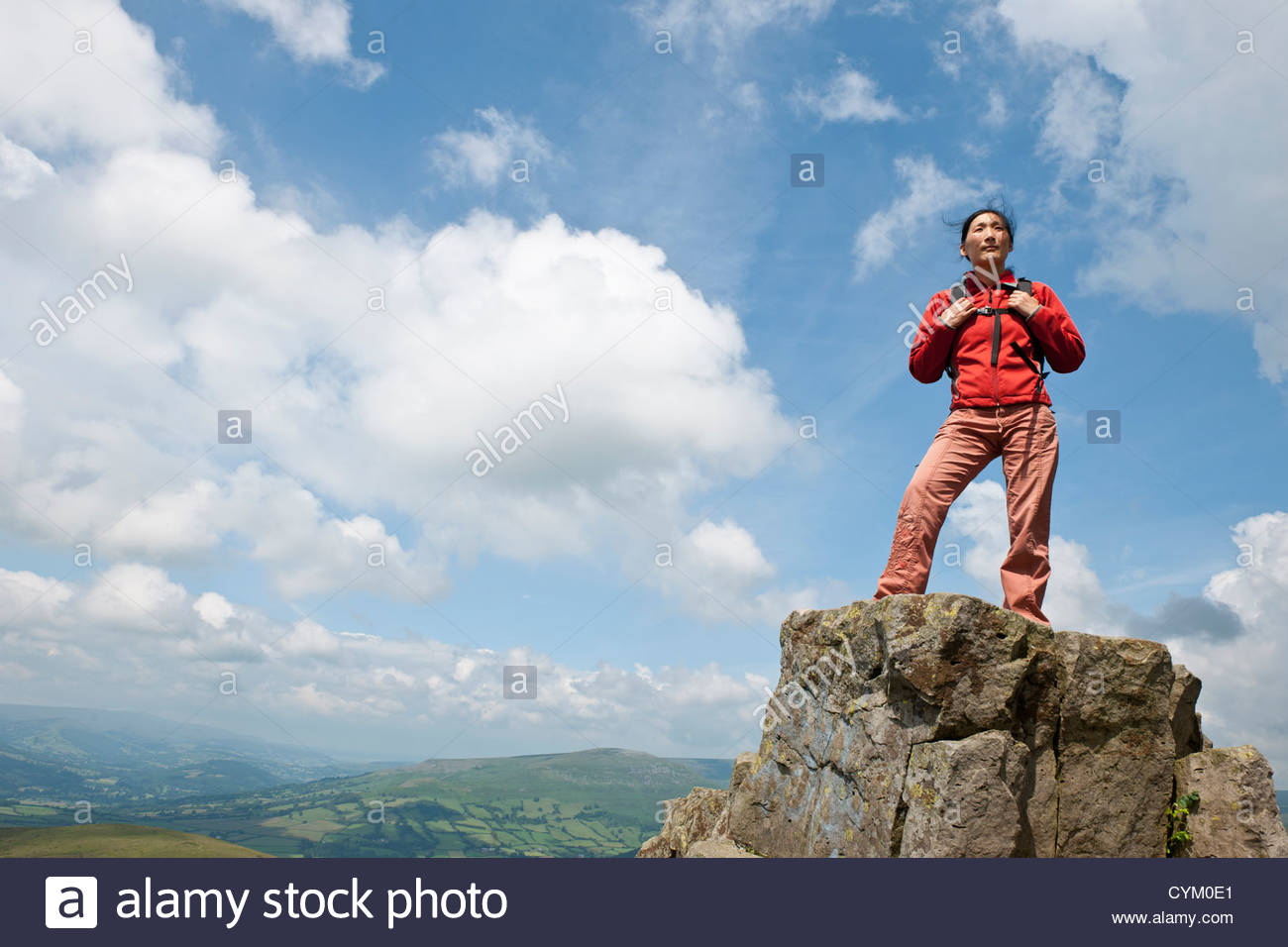 Woman standing on rural hilltop Photo Stock