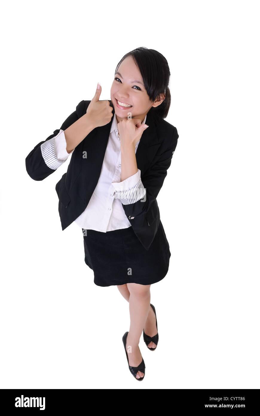 Smiling business woman avec expression d'excitation, pleine longueur portrait isolé sur fond blanc. Photo Stock