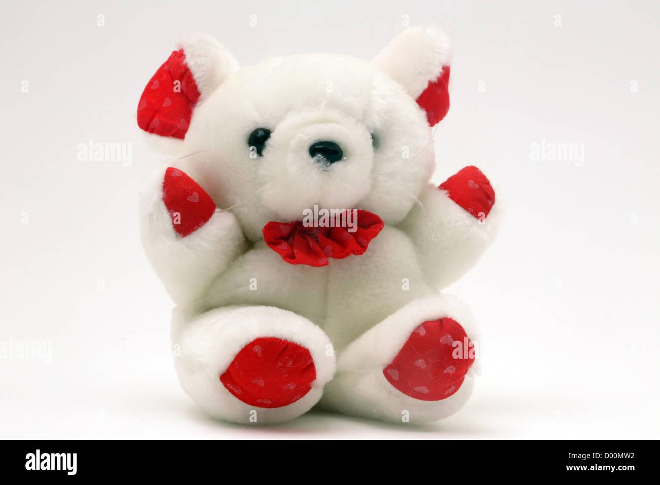Ours blanc et rouge avec Bow Photo Stock