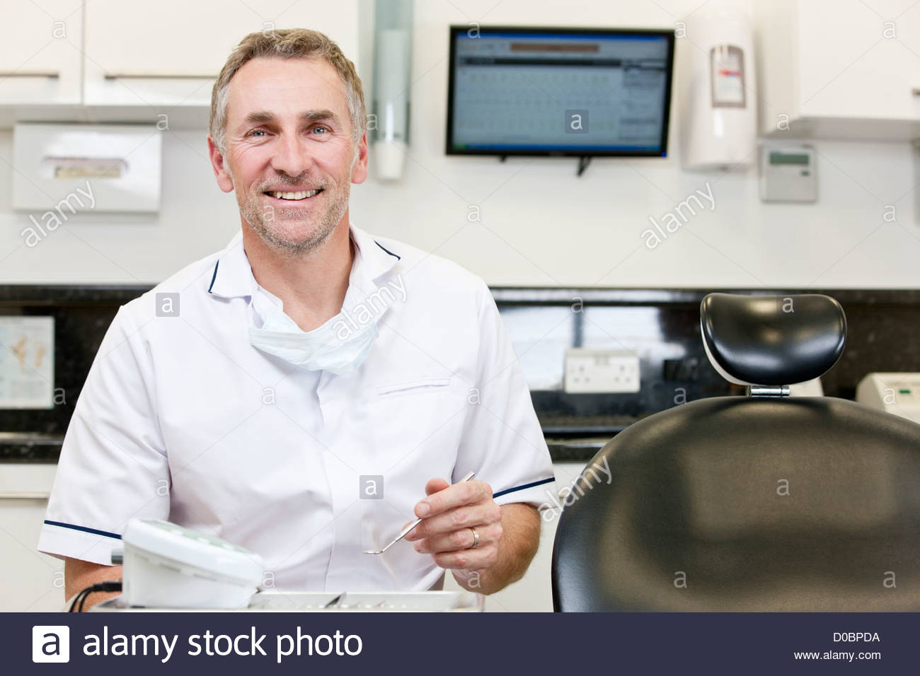 A male dentist in a dental surgery Photo Stock