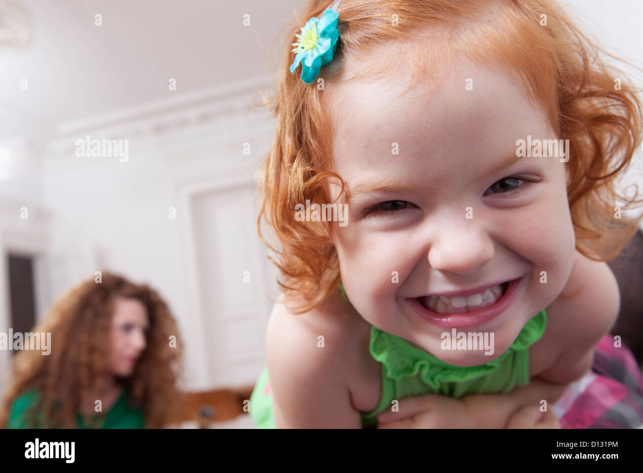 Allemagne, Berlin, Girl having fun at home, woman in background Photo Stock