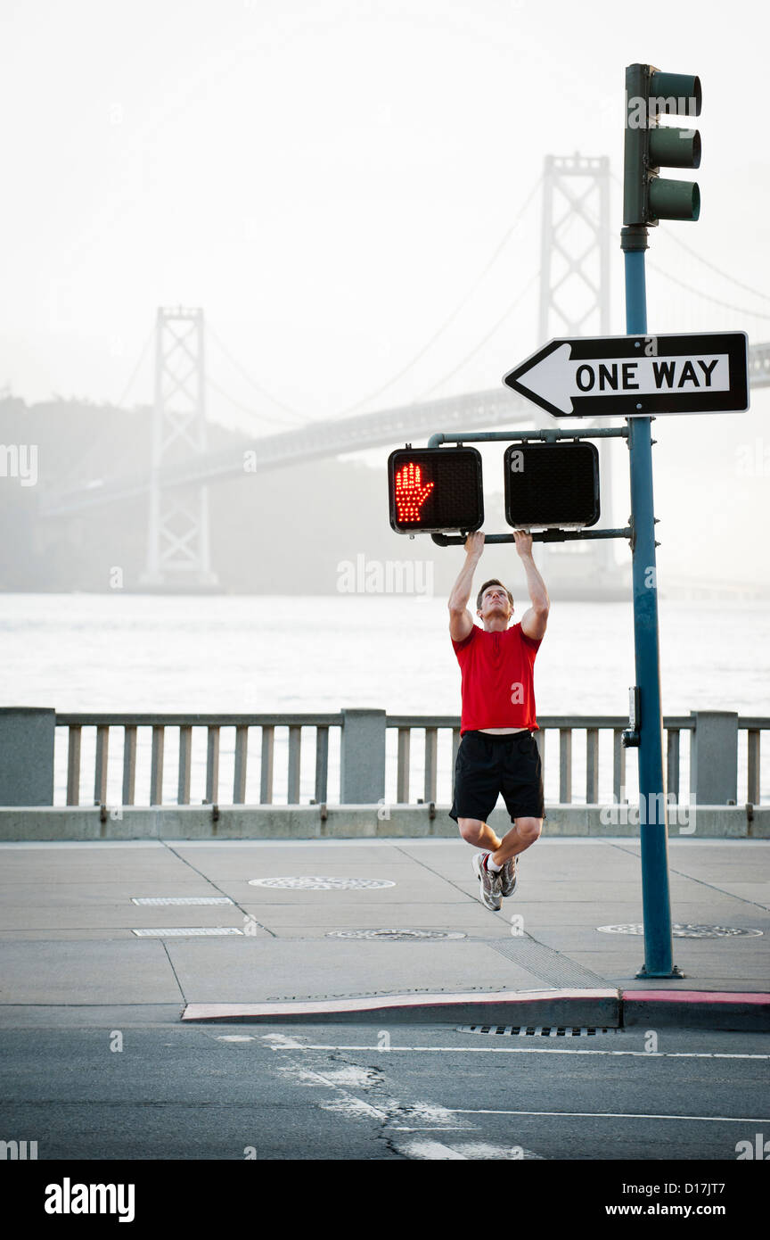 Man exercising on city street Photo Stock