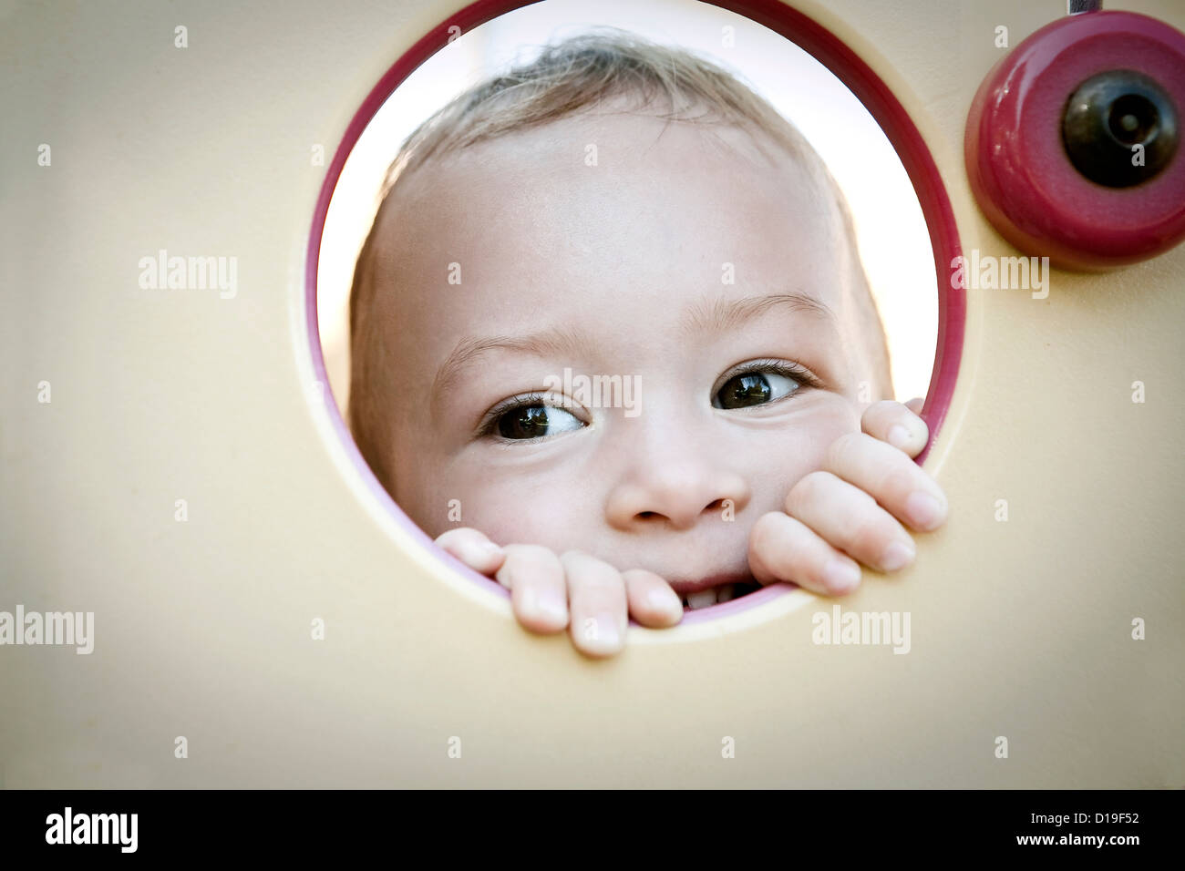 Girl peeking through circle Photo Stock