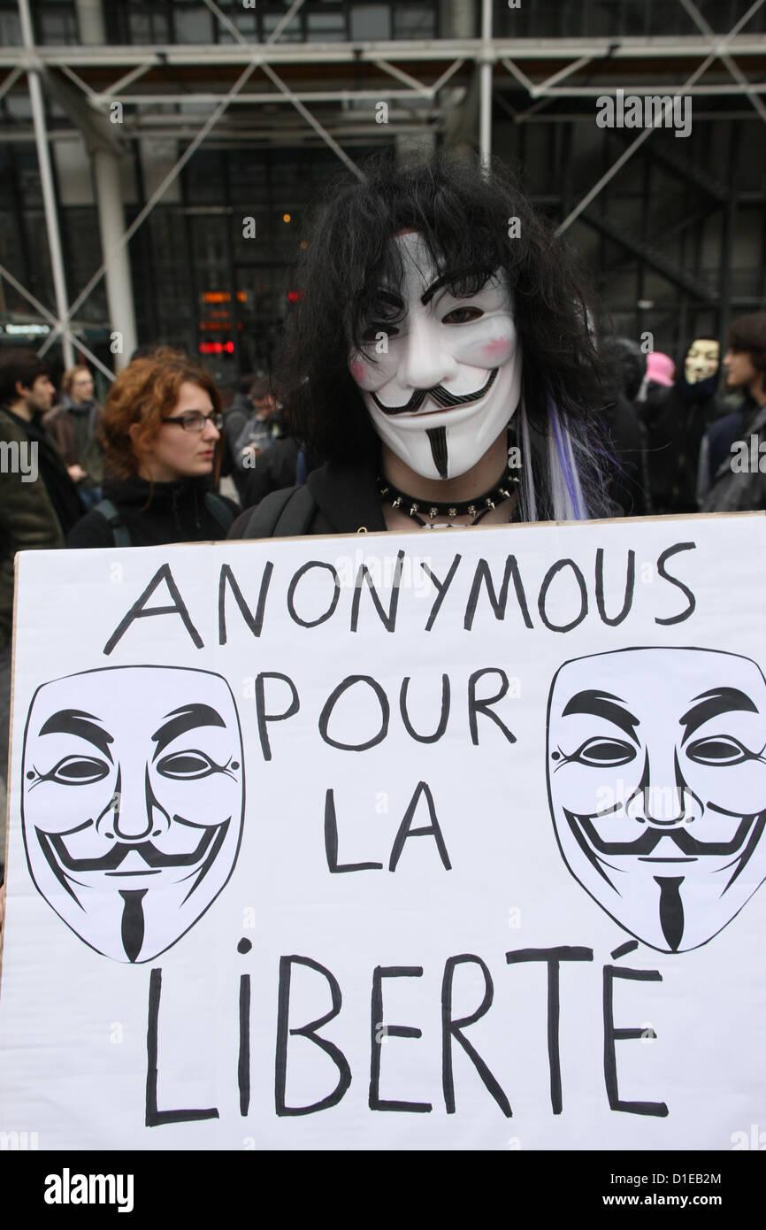 Manifestant portant masque de Guy Fawkes le mouvement anonyme et basé sur un personnage dans le film V pour Photo Stock