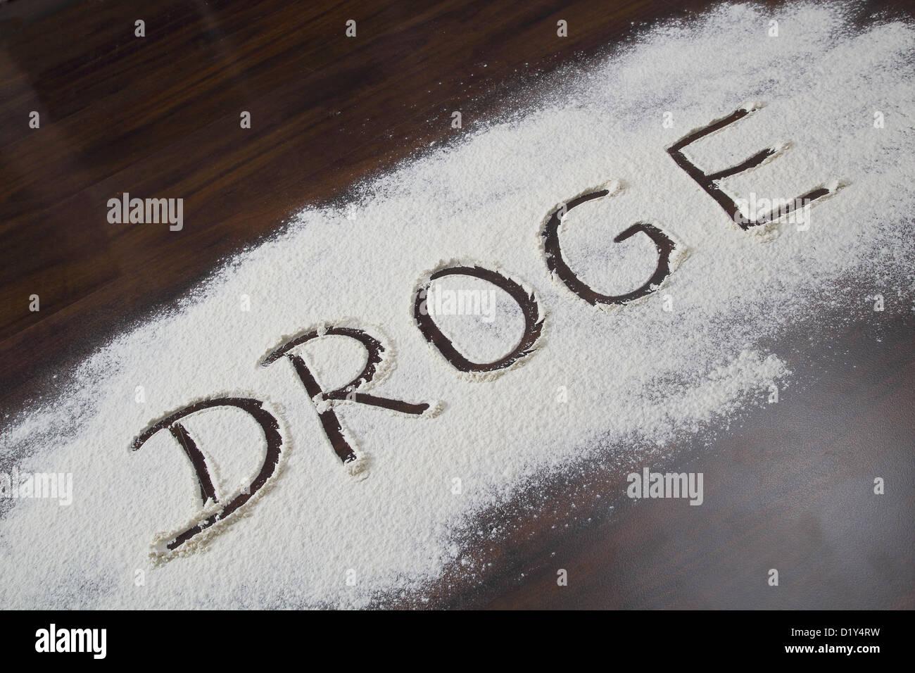 Le mot allemand pour les écrits en poudre blanche Photo Stock