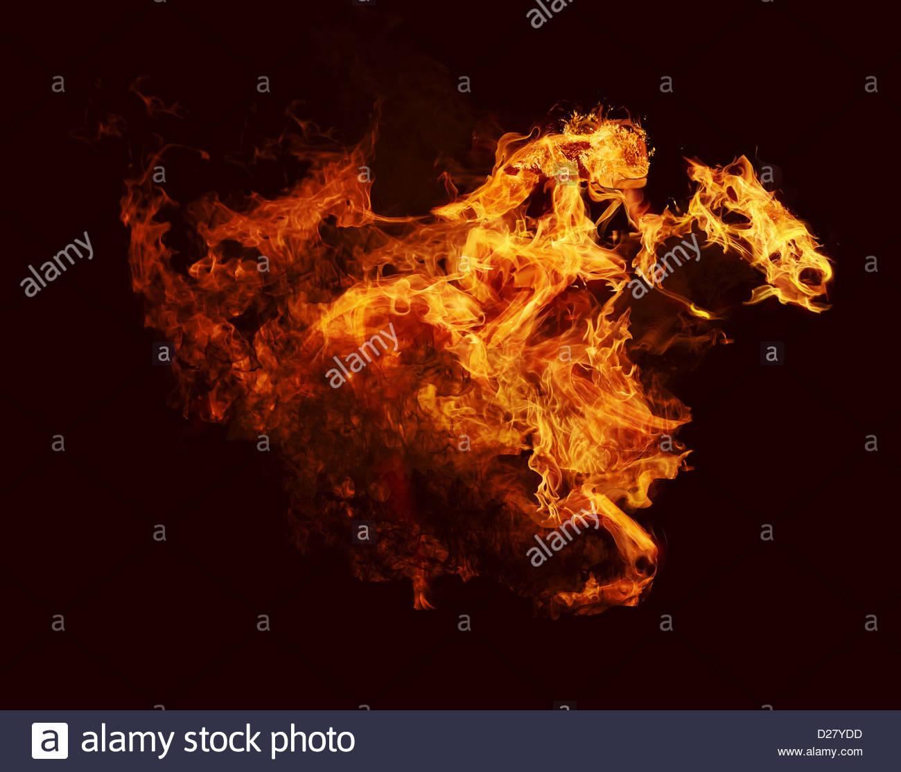 Flammes en forme de cheval et jockey Banque D'Images