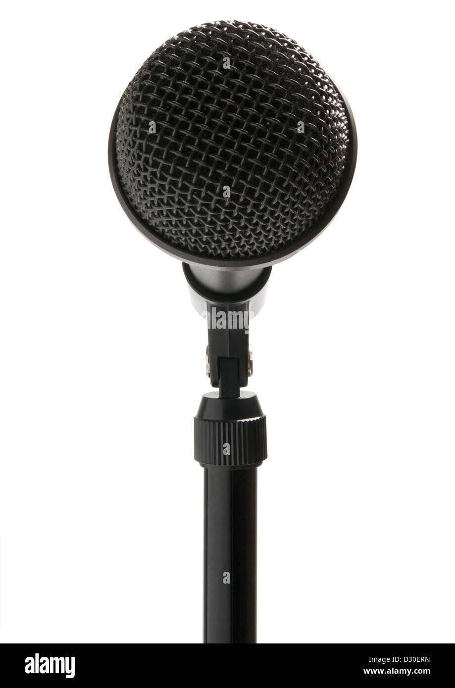 Sur le stand de microphone sur fond blanc Photo Stock