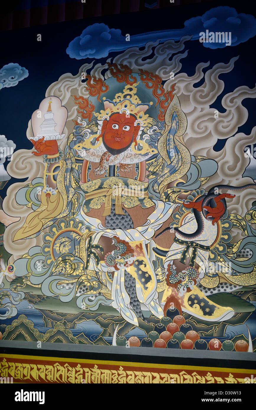Chenmizang, le roi rouge de l'ouest tenant un chorten et serpent, seigneur de les nagas (serpents), Trashi Chhoe Photo Stock
