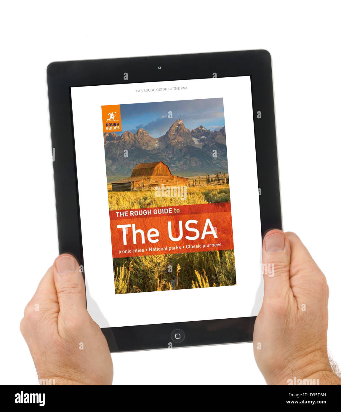 La lecture d'un guide approximatif avec carnet de voyage l'application Kindle sur un Apple iPad retina 4ème Photo Stock