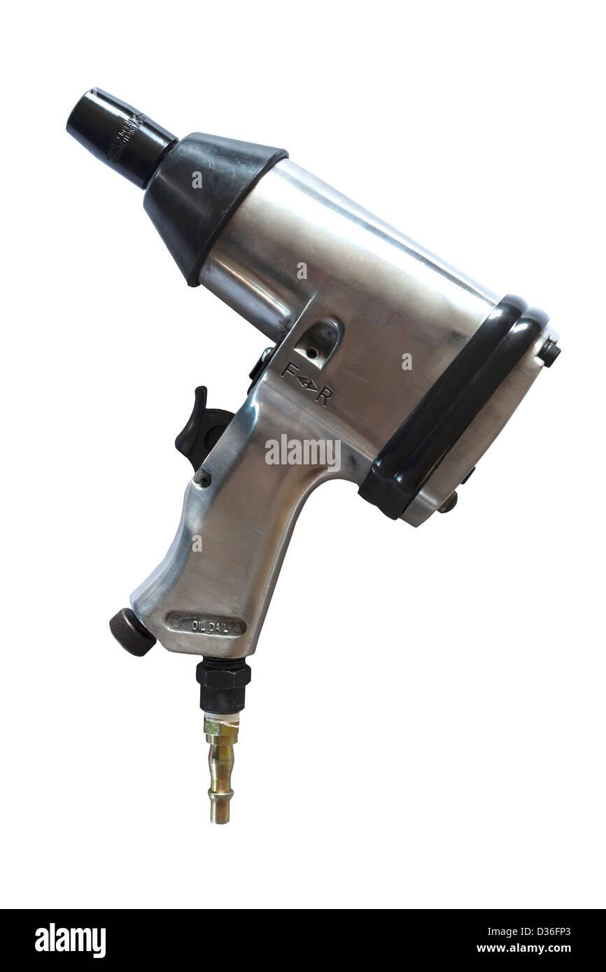 Un outil clé à choc de l'air à utiliser avec un compresseur d'air sur un fond blanc Photo Stock