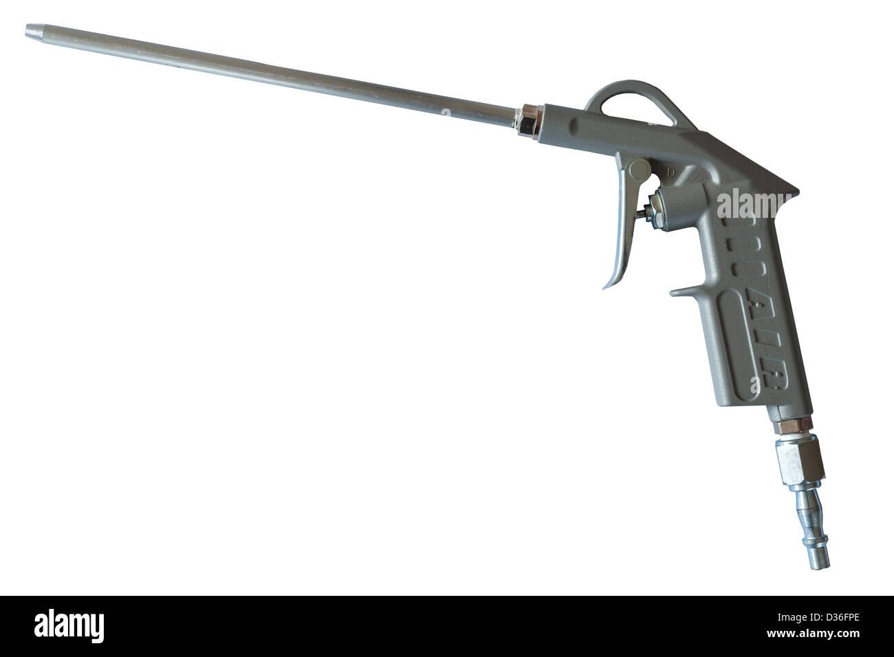 Dépoussiérant un outil à utiliser avec un compresseur d'air sur un fond blanc Photo Stock