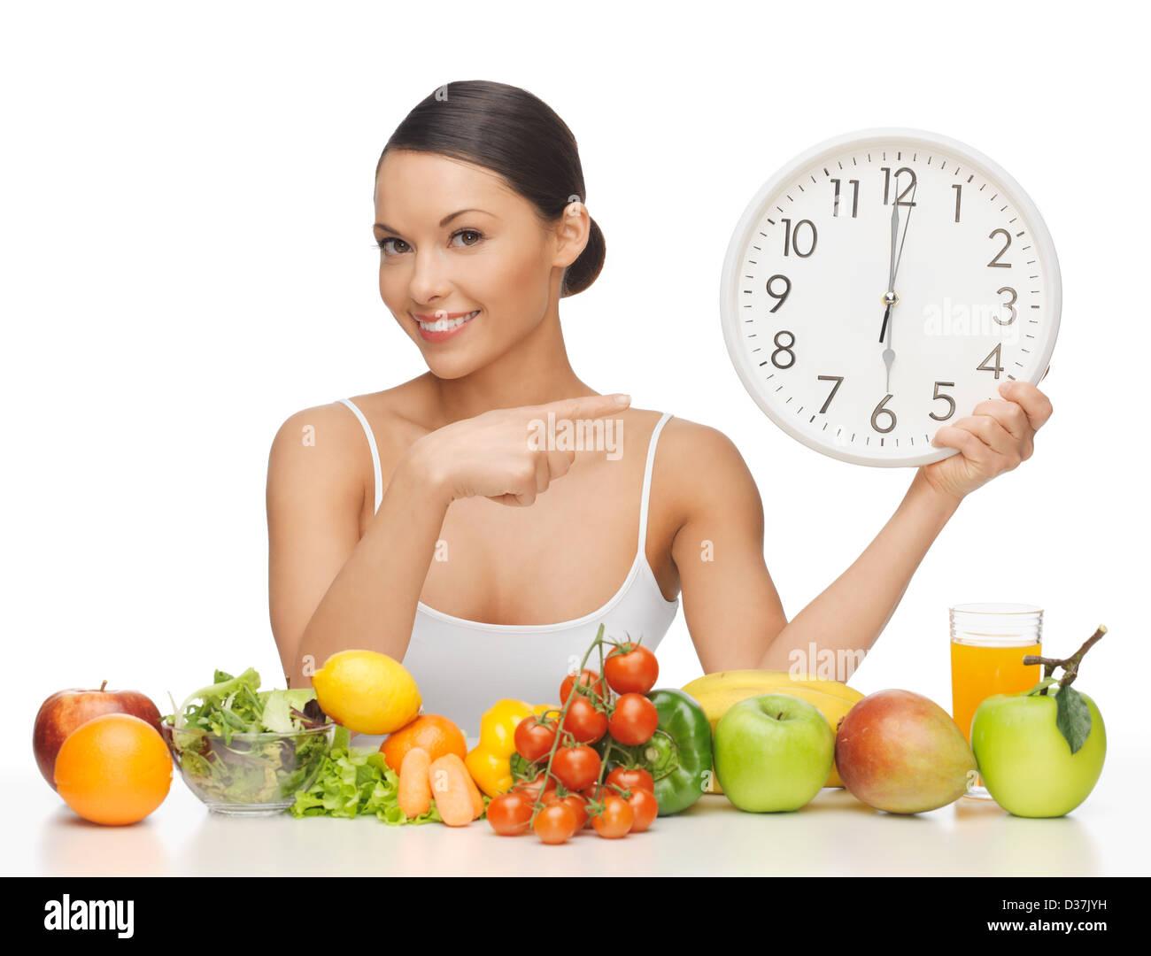 Femme avec grosse horloge Photo Stock