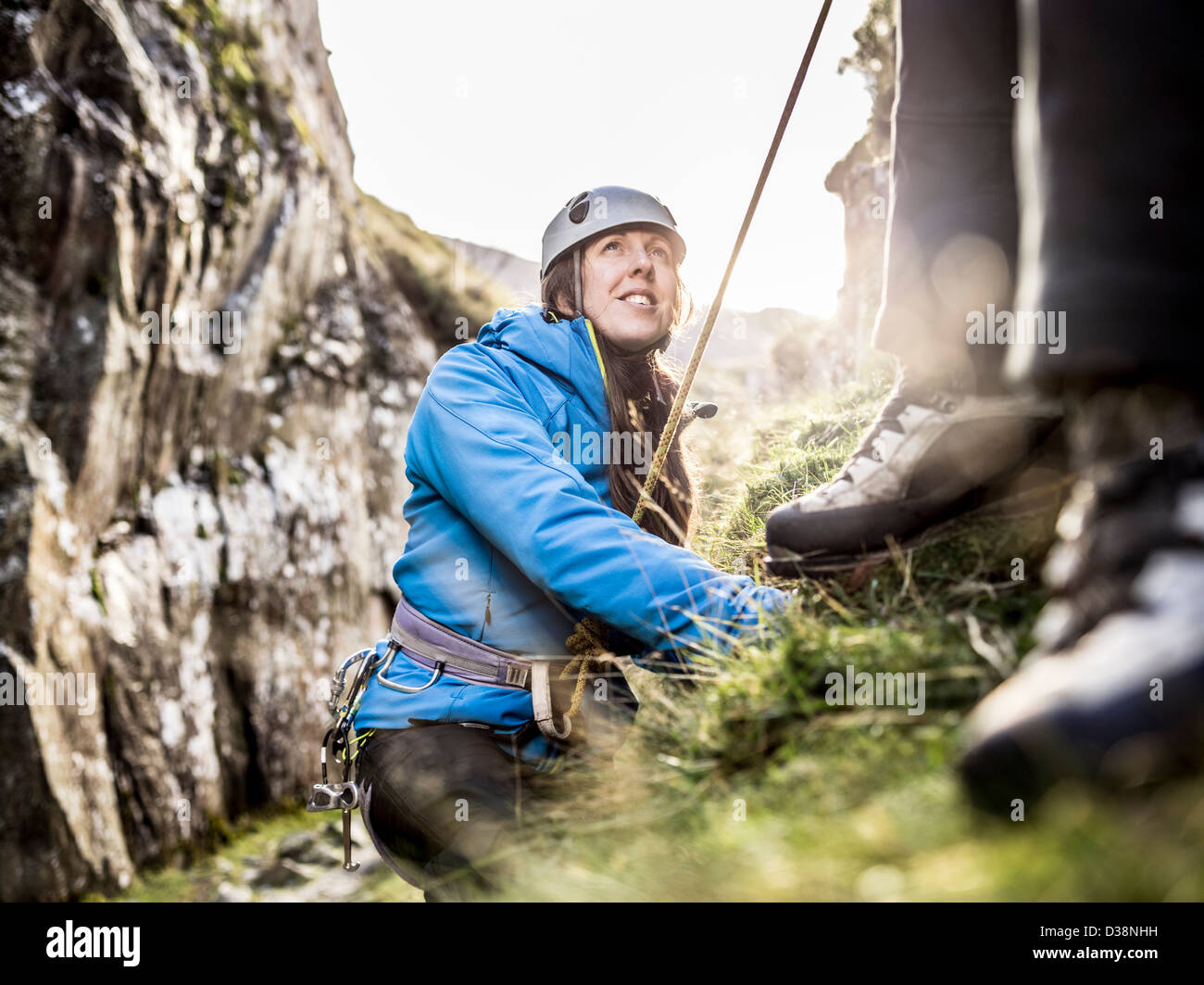 Rock climber scaling steep rock face Photo Stock