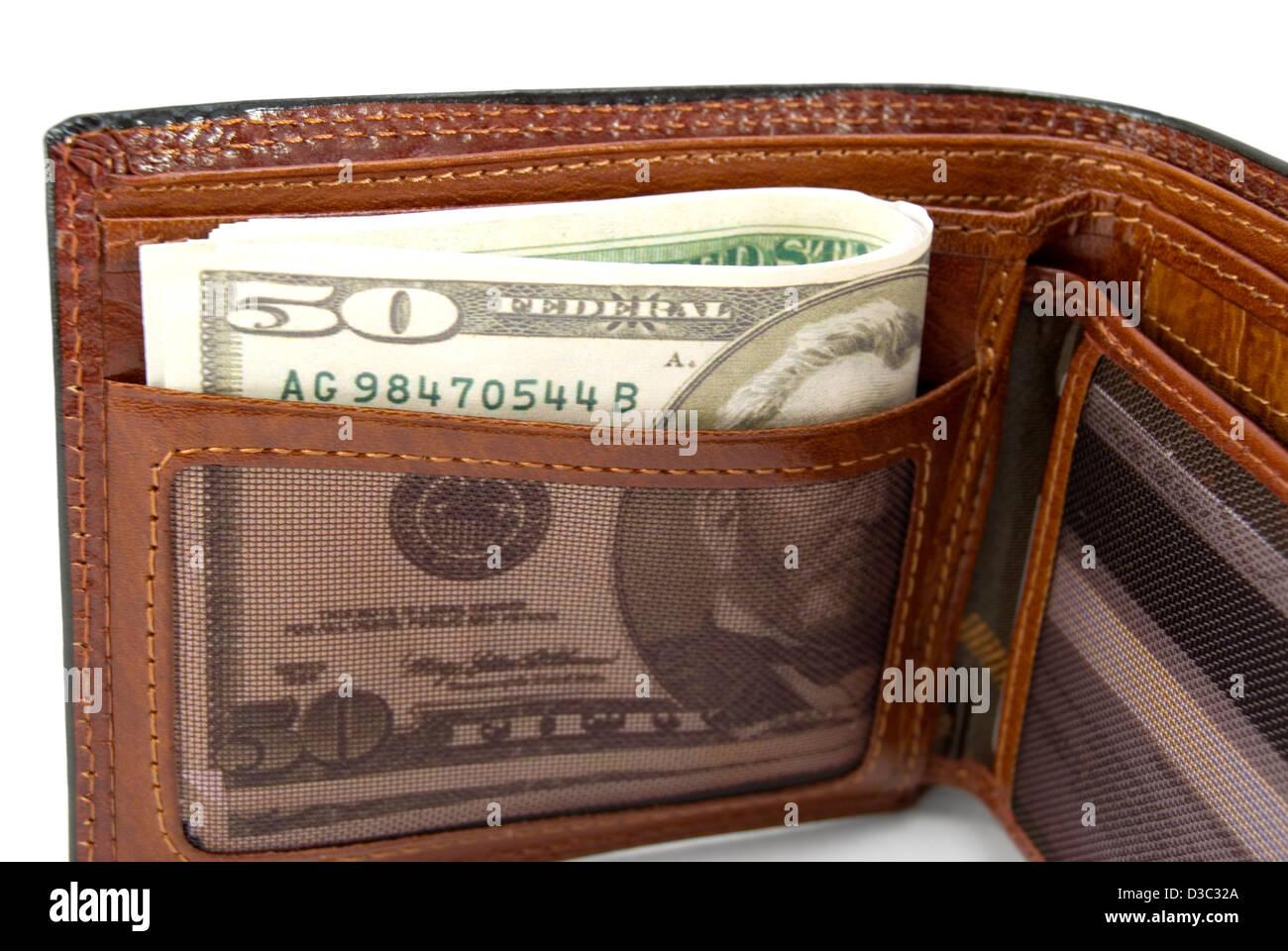Le sac à main marron avec de l'argent est photographié un close-up Photo Stock
