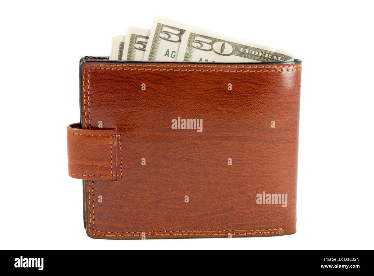 Le sac à main marron avec de l'argent est photographié sur un fond blanc Photo Stock