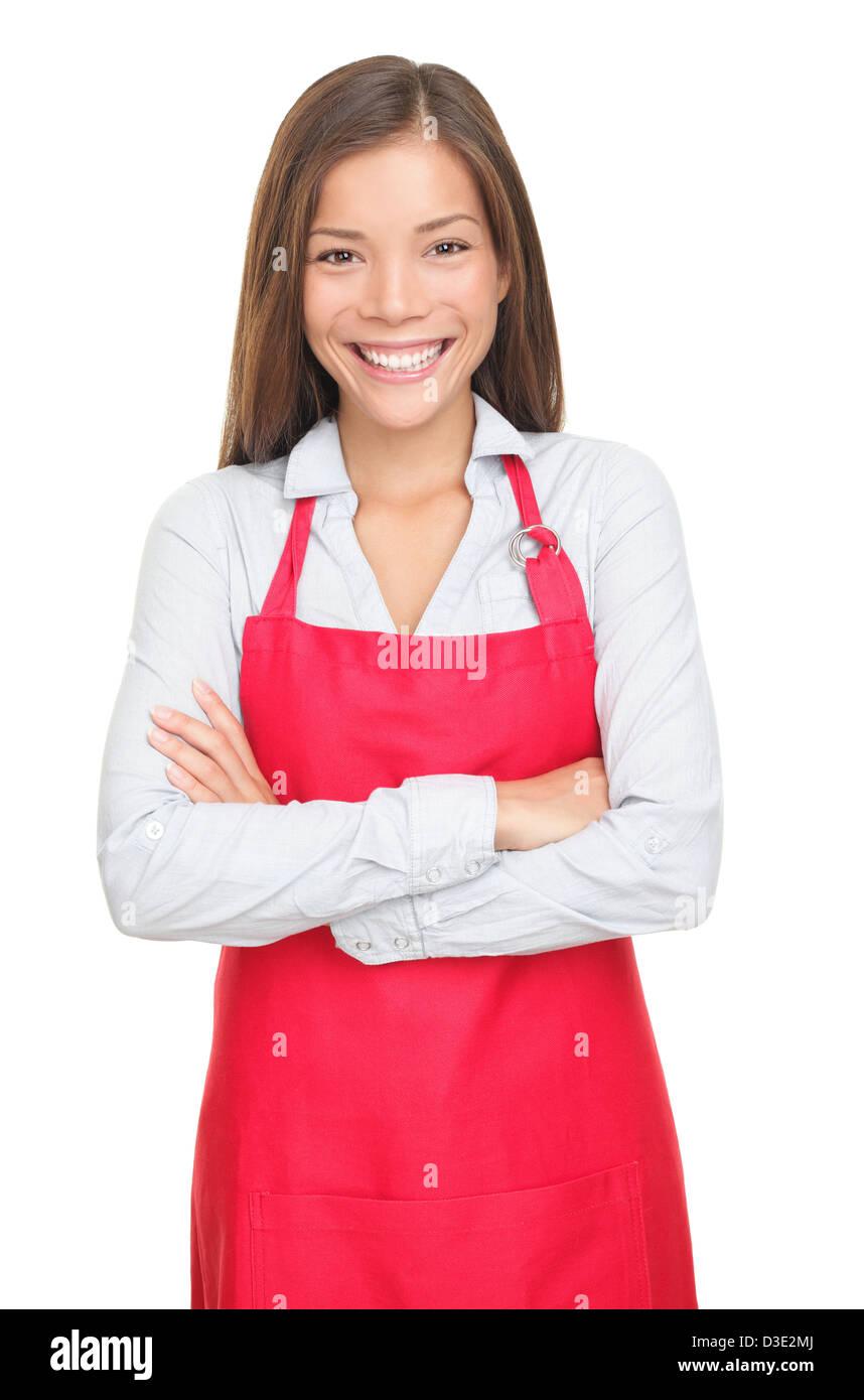 Portrait of happy young female sales clerk ou petit magasin propriétaire avec les bras croisés isolé Photo Stock